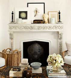 Summer style! White stone fireplace and mantle against matching walls! Wonderful accessories in neutral colors but LOTS of textures and patterns!