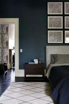 Deep blue bedroom walls, gray accents