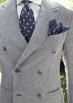 Try pairing a monochrome houndstooth double breasted blazer with a white classic shirt for a classic and refined silhouette.   Shop this look on Lookastic: https://lookastic.com/men/looks/white-and-black-double-breasted-blazer-white-dress-shirt-navy-and-white-tie/9662   — White Dress Shirt  — Navy and White Polka Dot Tie  — Navy Pocket Square  — White and Black Houndstooth Double Breasted Blazer