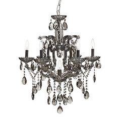 Imagine thischandelier hanging from a grand tent - I know tenting is super expensive but I must have a tented wedding and alternating black and tuqoius chandeliers hanging from within to create a romantic and chic feel.