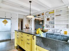 PHOTOS: Cabinet trend says bye-bye white, hello color