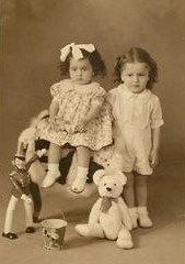 antique photo- sister and brother with their toys