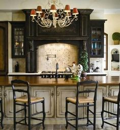 To die for! Cream cabinets on lowers and black cabinets on uppers.