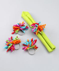 Napkin holders... would be SO easy to make.  Just key rings and curled ribbon!  Whaaaaat!?