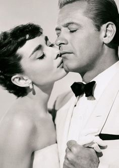 "Audrey Hepburn / Born: Audrey Kathleen Ruston  May 4, 1929 in Ixelles, Belgium  Died: January 20, 1993 (age 63) in Tolochenaz, Switzerland / with William Holden in ""Sabrina"""