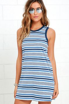 Whether going to see a concert or having brunch with a cute date, the Rhythm The Strokes Blue Multi Striped Dress is the epitome of casual-cool! The sleeveless bodice is topped with a crew neckline. Arm and neck openings are trimmed in a navy blue color, framing the light blue, slate blue, navy blue, and ivory striped, wide-cut dress. Small logo tag at bottom.