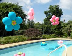 oh hey pool balloon decorations!  Love these floating flowers!