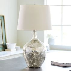 Make a glamorous statement in any room with our Mercury Glass Lattice Lamp. An etched lattice pattern lends extra detail to the heavily mottled mercury glass base.