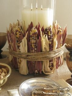 FOR A FALL ACCENT/CENTERPIECE THIS IS VERY SIMPLE, HURRICANE JAR, CANDLE, CORN & TWINE & (PROBABLY SOME GLUE TO KEEP THE CORN MOBILE TOGETHER WHEN WRAPPING IT UP IN TWINE & VOILA....EASY DECORATIVE PIECE ...