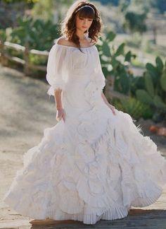 I'm obsessed. I never thought I'd like such a big dress, but I do. I love it. Dress by Joan Shum (a Long Beach native!)