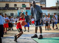 Former NBA basketball player Dikembe Mutombo gives instructions to Cuban children during clinical organized by the NBA FIBA Americas and Cuban...