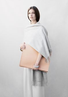 Accessories have become such an important element in everyday's fashion. With the constant rush of life, their flexibility also has transformed over time. Having that idea in mind, Paris-based industrial designer Isabelle Bois collaborated with & Other Stories, a womenswear fashion company founded in Sweden, to generate a capsule collection of bags, pouches, and cases.