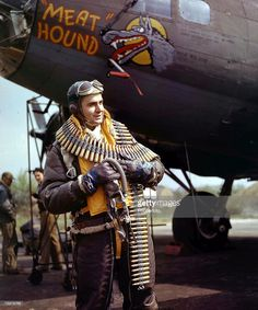 "Waist gunner Staff Sergeant Frank Lusic poses in front of the B-17F ""Meat Hound"" of the 306th Bomb Group, 423rd Bomb Squadron based in Thurleigh, England (May 4, 1943), via Getty Images"