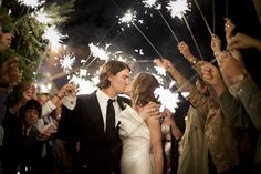 """Emily and Patrick - It was absolutely magical to walk from our dinner down to the dance with all of our family and friends lining the path with """"sparks flying""""! It was one of my favorite memories from our wedding. It really made the night special--adding warmth and excitement for everyone there. - Olive Juice Studios Photography"""