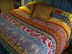 What a beautiful collection of colorful and boho quilts.  Cjj