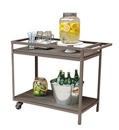 Keep an outdoor bar cart stocked with mixed drinks and extra dishware to avoid running in and out of the house! Bar cart, $146. Shop now at http://www.walmart.ca/en/ip/hometrends-sedgwick-bar-cart/6000195534581 | #barcart #outdoorentertaining #outdoorliving #walmart #hometrends