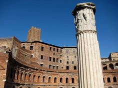 Forum of Trajan, Rome - Trajan's Forum:The monumental brick walls still stand.The emperor Trajan funded its construction(the last one to be built)with the spoils from the conquest of Dacia which ended in 106CE.