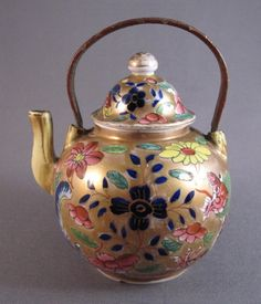 "Miniature ""clobbered"" teapot, c.1700. A tiny Chinese porcelain teapot made during the Kangxi period (1662-1722)."