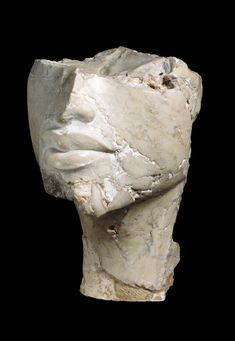 Lower part of a sculptured head from a limestone figure of Akhenaten. Amarna British Museum