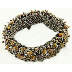 @Overstock - This Capullo bracelet features a hand-woven base of Czech glass seed beads that is richly fringed with an assortment of Czech glass beads and tiger's eye chips. This bracelet fits comfortably and securely with a hidden magnetic clasp.http://www.overstock.com/Worldstock-Fair-Trade/Tigers-Eye-Capullo-Bead-Bracelet-Guatemala/6504754/product.html?CID=214117 $20.49