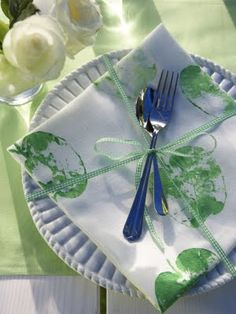 Cute - tie the silverware and napkins to the plate with a cute bow!