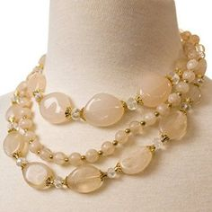 Dress up your favorite summer styles with this Multi-Strand Bead Necklace. You'll love how the clear glass faceted beads and beads colored with soft pinks and neutral tones pop with subtle gold accents.