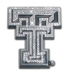 Texas Tech University Logo Silver Austrian Crystal Chrome Auto Emblem is for the Texas Tech University or Texas Texas Tech Red Raiders sports fan made of silver chrome with large Texas Tech University text logo with authentic silver austrian crystals for the ultimate glitter effect. It has a high sparkle in the day from sunlight and from street lights and other auto headlights with the austrian crystals.