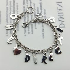 One Direction 1D Directioner letters bracelet. Hot merchandise! | StylrPlus