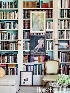 House Beautiful, built in, bookcase, bookshelves, cream book case, shelves, sconces, art on shelves, shelf