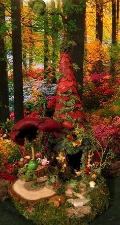 Ƹ̵̡Ӝ̵̨̄ƷThis fairy house is named Rubys Fairy Garden Party. It is made of wood and has been painted a dark forest green. The roof is made up