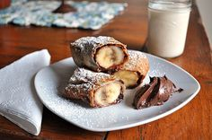 Nuts for Nutella: 24 Nutella Recipes to Make Now! via Brit + Co. -> Banana Nutella Egg Rolls: A terrific egg roll recipe for dessert or breakfast Just Desserts, Delicious Desserts, Dessert Recipes, Yummy Food, Nutella Rolls, Yummy Treats, Sweet Treats, Banana Roll, Banana Split