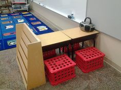 Listening center corner - love that setup. Desks take up less room than a table.