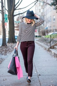 striped sweater, floppy hat, and maroon jeans. Perfect for warmer winter days!