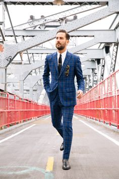 Suit: Hardy Amies,  Boots: Sandro, Shirt and tie: Brooks Brothers