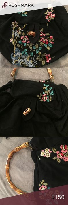 Anthropology embroidered purse with bamboo handle Spectacular, limited edition  bamboo handle embroidered purse from Anthropology.  Great condition.  Numbered art (see picture) Anthropologie Bags Shoulder Bags