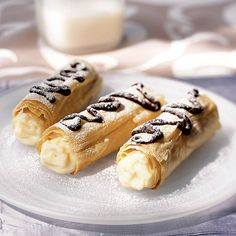 For this elegant dessert, sweetened phyllo is wrapped around aluminum foil molds to form hollow pastries that are filled with vanilla cream. If you have cannoli molds, use them instead. You can prepare the phyllo shells and vanilla cream up to a day ahead. Store shells in an airtight container at room temperature, and the vanilla cream in a zip-top plastic bag in the refrigerator.