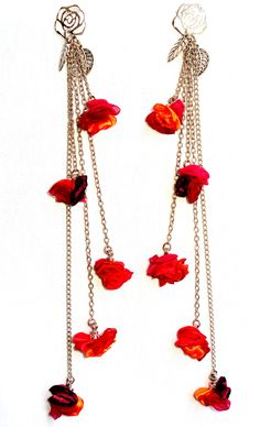 Aros Antonieta en tonos fucsia, naranja, lila. Base hipoalergenica flor grande, cristales facetados y 5 flores pequeñas....super livianos