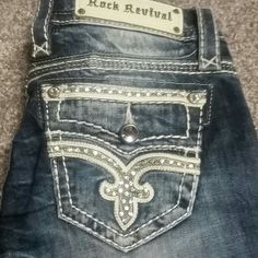 NWOT Rock Revival denim bling stick jeans 26 I HATE to sell these because I paid $175 for them but I haven't worn. These are truly amazing. Boot cut. High stitch detail with bling. No trades no PP please dont ask! Rock Revival Jeans Boot Cut