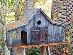 This nice and wild themed bird house is inspired from the tree-house designs. Its big and beautiful rustic styled bird house with the window and main gate, giving it realistic look. The overall impact is that of a farm house or a barn. Its simple and artistic. #birdhouseideas