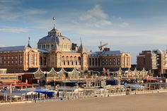 The Hague: Steigenberger Kurhaus Hotel dating back almost 200 years in the former fisherman's village of Scheveningen. Initially a wooden bathing house before being replaced by a stone structure in 1826