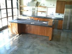 polished concrete floor with soapstone counter