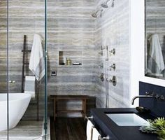 All-marble double shower with teak floor boards