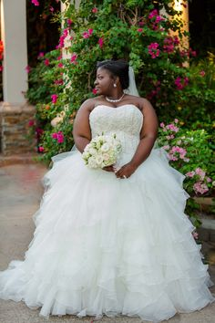 David's Bridal bride Candace in a strapless ball gown with sweetheart neckline, beaded and embroidered bodice and ruffled tulle skirt for her glamorous Houston wedding.