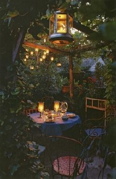 Pretty lighting and fragrant plants = covered, inviting area to read, have coffee or eat