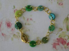 Green and gold button bracelet.  Interesting way to join buttons--with large jump rings.