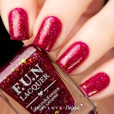 FUN Lacquer Best Dressed is a red jelly polish with iridescent flakes and holographic microglitter. This nail polish is handcrafted and designed by Yuin Ying, c