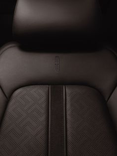 Luxurious chocolate leather seats with intricate stitching in the Lincoln MKC from the Indulgence theme. #LincolnBlackLabel