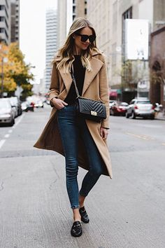 blonde woman wearing long camel jacket black sweater topshop denim skinny jeans gu – Ayşenur Ece – Join the world of pin Cold weather look - long coat 🧥, black sweater, skinny jeans, black slides Camel coat and black sweater with black mules. Mode Outfits, Fall Outfits, Casual Outfits, Fashion Outfits, Fashion Vest, Grunge Outfits, Fashion Clothes, Fashion Accessories, Looks Chic