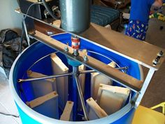 Honey Extractor by Chris -- Homemade honey extractor constructed from a food grade plastic barrel, stainless steel tubing and plate, bearings, and an electric motor. http://www.homemadetools.net/homemade-honey-extractor-3