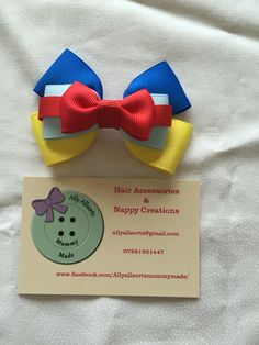 Snow White inspired hair bow  designed by me
